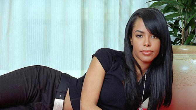"FILE - This May 9, 2001 file photo shows R&B singer and actress Aaliyah posing for a photo in New York. Recording artist Drake, a huge Aaliyah fan, has announced that he is working on a posthumous album of Aaliyah music, and he's already released the song ""Enough Said"" featuring himself and the singer, who was killed in a plane crash in 2001. (AP Photo/Jim Cooper, file)"