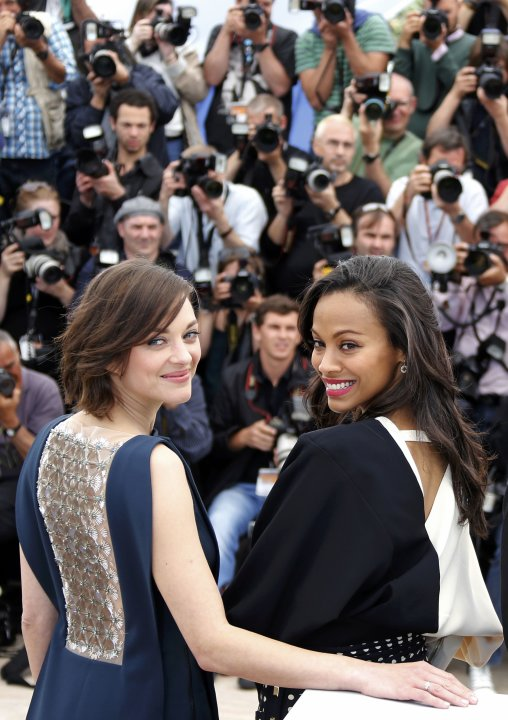 "Cast members Marion Cotillard and Zoe Saldana poseduring a photocall for the film ""Blood Ties"" at the 66th Cannes Film Festival"
