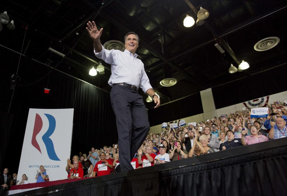 Republican presidential candidate and former Massachusetts Gov. Mitt Romney waves to supporters as he arrives at  a rally Friday, Sept. 21, 2012, in Las Vegas. (AP Photo/Julie Jacobson)