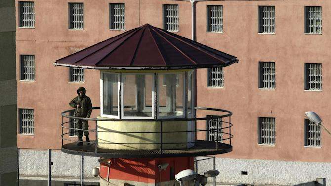A guard stands on a watch tower at Gldani prison No. 8 in Tbilisi, Georgia, Sunday, Jan. 13, 2013. Nearly 200 inmates considered political prisoners by Georgia's new parliament have walked free under an amnesty strongly opposed by President Mikhail Saakashvili. Many of those who walked free on Sunday were arrested during anti-Saakashvili protests in May 2011. Others had been convicted of trying to overthrow the government or of spying for Russia. (AP Photo) Shakh Aivazov