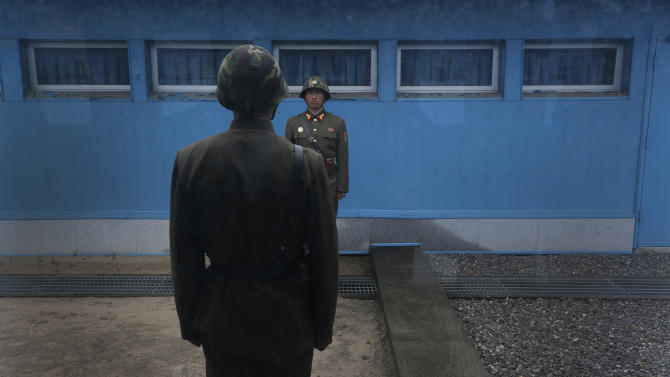 "North Korean soldiers stand guard on the demarcation line of the Demilitarized Zone that separates the two halves of the Korean peninsula at Panmunjom, North Korea on Monday, April 23, 2012. North Korea promised Monday to reduce South Korea's conservative government ""to ashes"" in less than four minutes, in an unusually specific escalation of recent threats aimed at its southern rival. The statement by North Korea's military, carried by state media, comes amid rising tensions on the Korean peninsula. Both Koreas recently unveiled new missiles, and the North unsuccessfully launched a long-range rocket earlier this month. (AP Photo/Vincent Yu)"