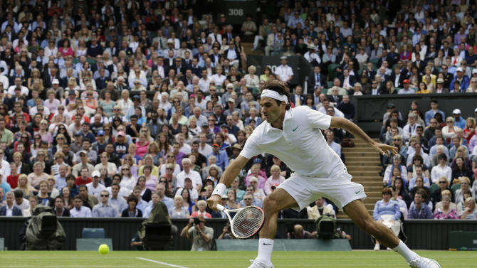 Roger Federer of Switzerland plays a return to Mikhail Youzhny of Russia during a quarterfinals match at the All England Lawn Tennis Championships at Wimbledon, England, Wednesday July 4, 2012. (AP Photo/Anja Niedringhaus)