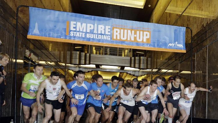 Contestants make their way up 86 flights of stairs at during the Empire State Building Run-Up, Wednesday, Feb. 6, 2013, in New York. (AP Photo/Frank Franklin II)