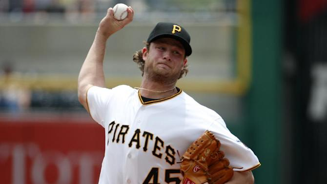 Pittsburgh Pirates' Gerrit Cole (45) delivers during the first inning of a baseball game against the Miami Marlins in Pittsburgh, Wednesday, May 27, 2015. (AP Photo/Gene J. Puskar)
