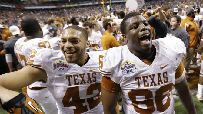 Texas' Caleb Bluiett (42) and Sedrick Flowers (66) celebrate following their win in the Alamo Bowl NCAA football game, Saturday, Dec. 29, 2012, in San Antonio.  Texas won 31-27. (AP Photo/Eric Gay)