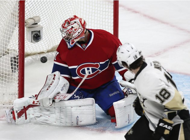 Pittsburgh Penguins James Neal looks on as Montreal Canadiens goalie Carey Price is scored on in Montreal