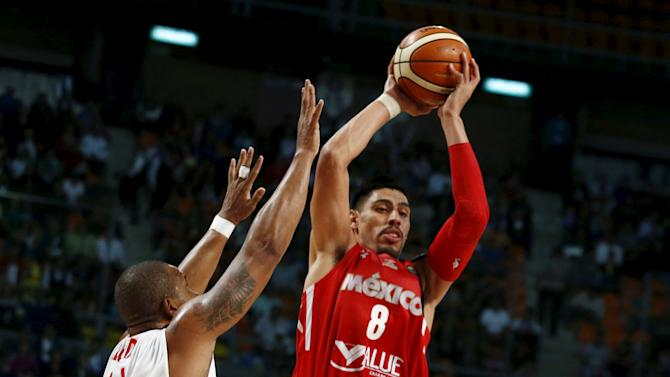 Mexico's Gustavo Ayon jumps for the ball with Panama's Jose Lloreda during their 2015 FIBA Americas Championship basketball game