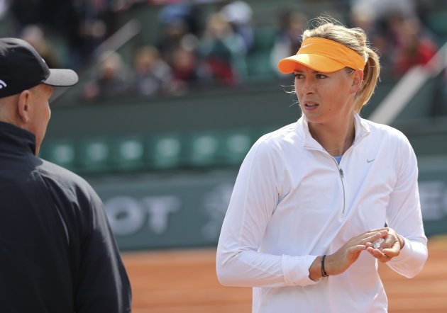 Sharapova of Russia listens to her coach Thomas Hogstedt during a training session for the French Open tournament at the Roland Garros stadium in Paris