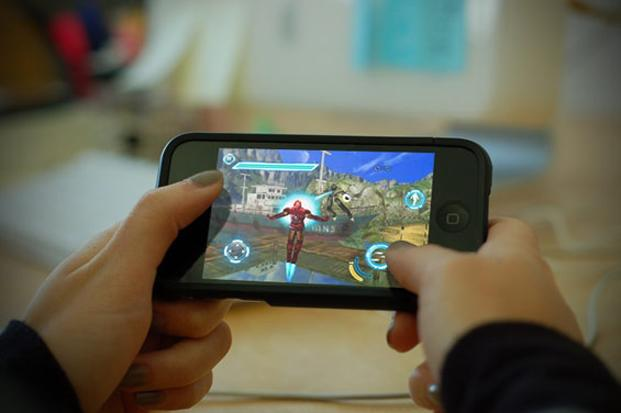 Tablets and smartphones are turning handheld gaming devices into a niche