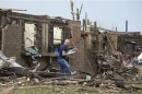 A man salvages his belongings after a tornado struck Moore, Oklahoma