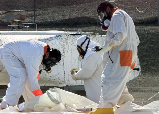 FILE -- In this March 23, 2004 file photo, workers at the tank farms on the Hanford Nuclear Reservation near Richland, Wash., measure for radiation and the presence of toxic vapors. Six underground radioactive waste tanks at the nation&#39;s most contaminated nuclear site are leaking, Gov. Jay Inslee said Friday, Feb. 22, 2013. Inslee made the announcement after meeting with federal officials in Washington, D.C. Last week it was revealed that one of the 177 tanks at south-central Washington&#39;s Hanford Nuclear Reservation was leaking liquids. Inslee called the latest news &quot;disturbing.&quot; (AP Photo/Jackie Johnston, File)