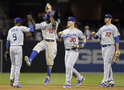 Harang pitches Dodgers past hometown Padres, 8-1
