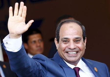 Egyptian President al-Sisi waves as he arrives to opening ceremony of New Suez Canal, in Egypt