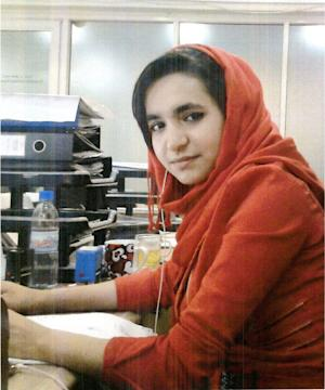 Afghan woman sought in alleged $1.1M bank theft