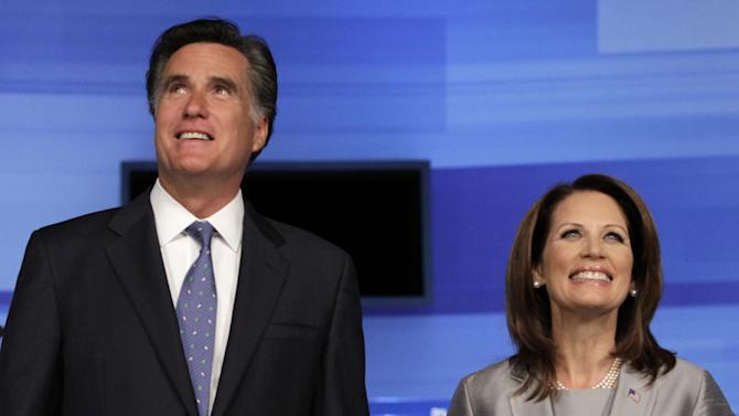 Republican presidential candidates former Massachusetts Gov. Mitt Romney and Rep. Michele Bachmann, R-Minn. pose for a photo before the start of the Iowa GOP/Fox News Debate at the CY Stephens Auditorium in Ames, Iowa, Thursday, Aug. 11, 2011. (AP Photo/Charlie Neibergall)
