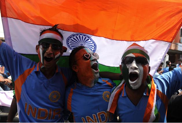 Indian cricket fans cheer in support of