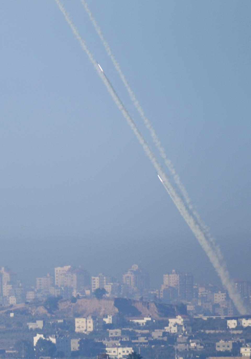 Rockets launched by Palestinian militants towards Israel make their way from the northern Gaza Strip, seen from the Israel Gaza Border, southern Israel, Thursday, Nov. 15, 2012.  (AP Photo/Ariel Schalit)