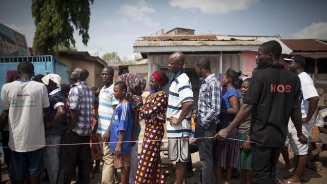 People wait in line to vote during an unexpected second day of voting, at a polling station in Tesano, Accra, Ghana, Saturday, Dec. 8, 2012. About 225 polling stations reopened Saturday for an impromptu second day of voting after there were technical breakdowns on the first day of voting, Ghana voting officials announced. Some voters waited in line all day Friday and then returned to vote on Saturday. (AP Photo/Gabriela Barnuevo)