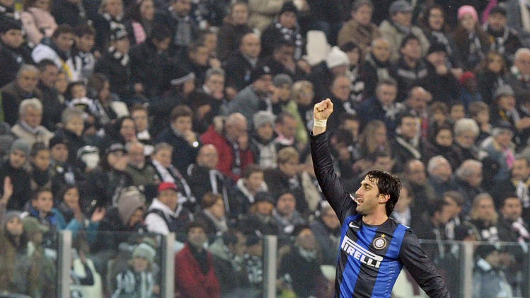 Inter Milan striker Diego Milito,of Argentina, celebrates after scoring his side's second goal during a Serie A soccer match between Juventus and Inter at the Juventus Stadium in Turin, Italy, Saturday, Nov. 3, 2012. Inter won 3-1. (AP Photo/Massimo Pinca)