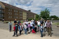 Asylum seekers stand in front of a residential home of the central aliens department of the eastern federal state of Brandenburg in Eisenhuettenstadt in 2011. The number of babies born in Germany sank to a record low in 2011, but a surge in immigration to Europe's top economy led its population to grow