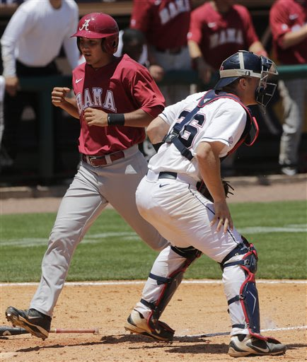Alabama's Daniel Cucjen crosses the plate with the winning run on a single by teammate Mikey White in the 10th inning of their Southeastern Conference tournament college baseball game against Mississi