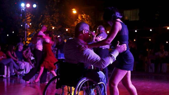A Lebanese man in a wheelchair performs with his partner during the second International Festival Tango in Byblos