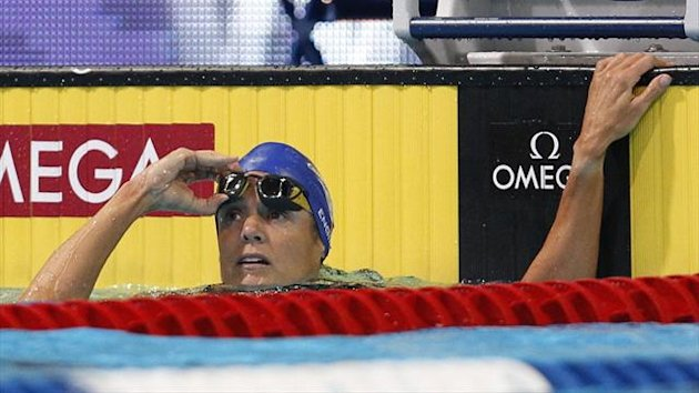 Dara Torres looks back at the clock after her women&#39;s 50m freestyle heats during the U.S. Olympic swimming trials in Omaha, Nebraska (Reuters)
