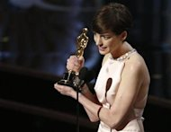 "Anne Hathaway accepts the award for best supporting actress for her role in ""Les Miserables"" at the 85th Academy Awards in Hollywood, California February 24, 2013. REUTERS/Mario Anzuoni"