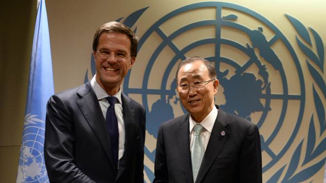 U.N. Secretary-General Ban Ki-moon (R) greets Netherlands' Prime Minister Mark Rutte before a meeting on the sidelines of the U.N. General Assembly in New York