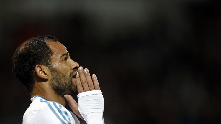Olympique Marseille's Saber Khalifa reacts after missing a scoring opportunity during their French Ligue 1 soccer match against FC Nantes at the Velodrome stadium in Marseille