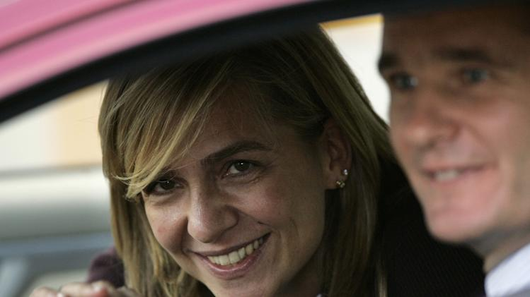 In this Nov. 2, 2005 file photo, Spain's Princess Cristina, left waves beside her husband Inaki Urdangarin from a car in Madrid, Spain. In an unprecedented court appearance on Saturday Feb. 8, 2014 for a direct descendent of a Spanish king, Princess Cristina will answer questions from a judge who has formally named her as a fraud and money laundering suspect. The case is a direct offshoot of one led by the same judge in an investigation of her husband Inaki Urdangarin for allegedly using his position as the Duke of Palma to embezzle public contracts via the Noos Institute, a supposedly nonprofit foundation he set up that channeled money to other businesses. Spain's royal family just wants the case that has now dragged on for years to end rapidly so the monarchy can try to rebuild the trust it once had. (AP Photo/Daniel Ochoa de Olza, File)