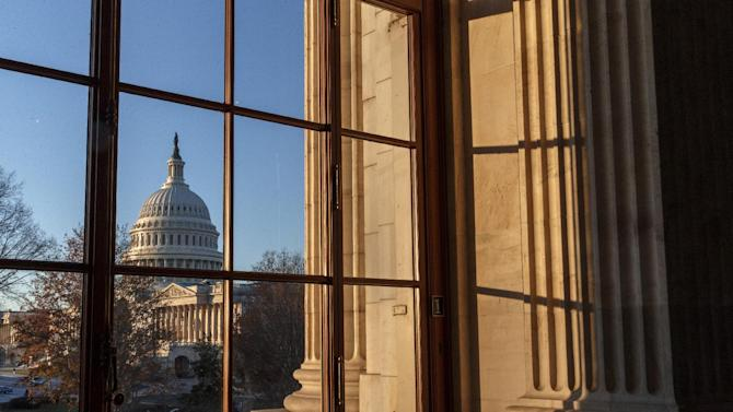 The U.S. Capitol is shown in Washington, Wednesday, Dec. 18, 2013. The Senate is on track to pass a modest, bipartisan budget pact that is designed to keep Congress from lurching from fiscal crisis to fiscal crisis and ease the harshest effects of the automatic budget cuts known as the sequester. (AP Photo/J. Scott Applewhite)