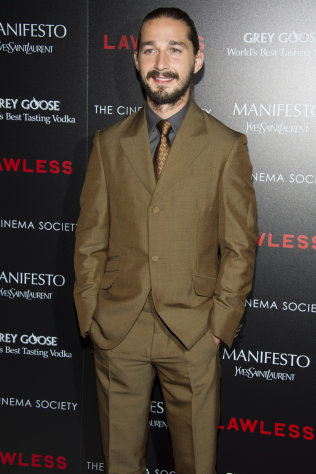 FILE - In this Aug. 13, 2012 file photo, Shia LaBeouf attends a screening of &quot;Lawless&quot; hosted by The Weinstein Company and The Cinema Society in New York. LaBeouf appears completely nude in Sigur Rs&#39; new music video in Lars Von Trier&#39;s The Nymphomaniac.&quot; LaBeouf can next be seen in Lawless, opening Wednesday, about a West Virginia moonshine business during the Prohibition era. (Photo by Charles Sykes/Invision/AP, File)