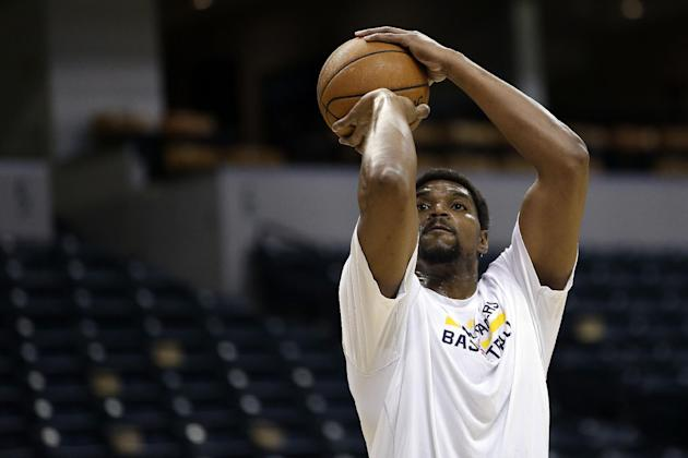Indiana Pacers center Andrew Bynum warms up before the Pacers played the Boston Celtics in an NBA basketball game in Indianapolis, Tuesday, March 11, 2014. Bynum is expected to make his debut with the