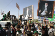 Afghans hold portraits of former Afghan President Burhanuddin Rabbani, who was killed last Tuesday, as they shout anti- government slogans during a demonstration in Kabul, Afghanistan, Tuesday, Sept. 27, 2011. Hundreds supporters of the former Afghan President marched on the streets of Kabul and condemned his killing. (AP Photo/Musadeq Sadeq)