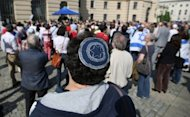 <p>A protester wearing a kippa attends a demonstration for the religious right of circumcision at Bebelplatz in Berlin. Around 500 mainly Jewish but some Christian and Muslim protesters have gathered in Berlin to demand the right to circumcision after a disputed court ruling in Germany outlawing the rite.</p>