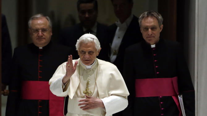 "Pope Benedict XVI, center, delivers his blessing in between his personal aide Georg Gaenswein, right, and Monsignor Leonardo Sapienza during his weekly general audience at the Vatican, Wednesday, Dec. 12, 2012. In perhaps the most drawn out Twitter launch ever, Pope Benedict XVI pushed the button on a tablet brought to him at the end of his general audience Wednesday. It read: ""Dear friends, I am pleased to get in touch with you through Twitter. Thank you for your generous response. I bless all of you from my heart.""Later in the day he was to respond to a few messages sent to him from around the world. As the countdown to his first tweet from his Twitter handle (at)Pontifex neared, the pope had garnered nearly 1 million followers in the eight languages of his account. (AP Photo/Gregorio Borgia)"