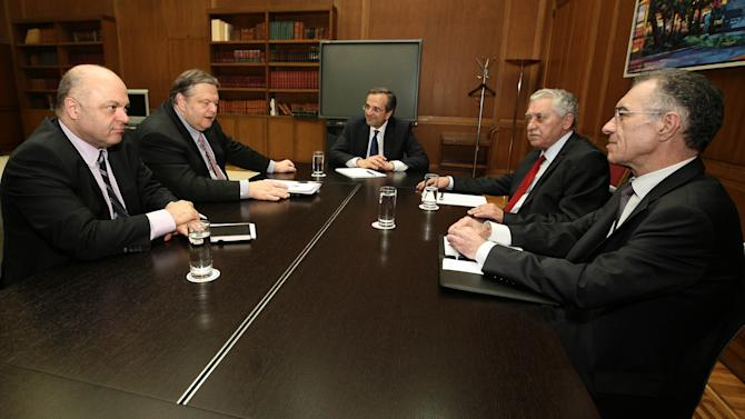 Greece's newly appointed Prime Minister Antonis Samaras, center, Leader of the Democratic Left party Fotis Kouvelis, second right, Greece's National Bank chairman Vassilis Rapanos, right, acting Finance Minister George Zanias, left, and leader of the Socialist PASOK party Evangelos Venizelos take part in a meeting at the parliament, prior to the EUROGROUP and ECOFIN meetings, in Athens, Wednesday, June 20, 2012. (AP Photo)