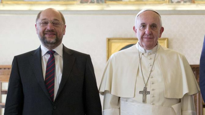 Pope Francis poses with European Parliament President Schuz during a meeting at the Vatican