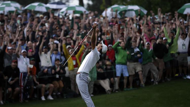 Adam Scott, of Australia, celebrates after making a birdie putt on the second playoff hole to win the Masters golf tournament Sunday, April 14, 2013, in Augusta, Ga. (AP Photo/David J. Phillip)