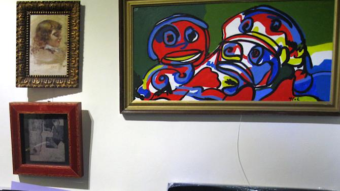 In this photo released by the Spanish Interior Ministry on Saturday, Feb. 28, 2015, different pieces of alleged fake art are seen inside a studio in Valencia, Spain. Spanish Police have broken up a network that allegedly created and sold fake works of art purporting to be by artists of international standing including Pablo Picasso, Andy Warhol and Joan Miro. Officers have arrested nine suspects in the eastern region of Valencia, including the alleged counterfeiters and intermediaries involved in selling the fakes. Investigators searched seven addresses and seized 271 works, including canvasses, sculptures and documents to be used to falsify the art's provenance. (AP Photo/Spanish Interior Ministry, HO)