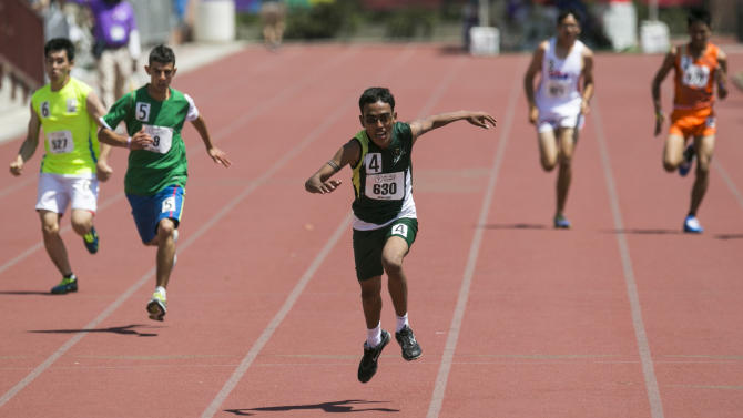 Ramie Irshad, from Pakistan, wins a 200-meter race at the Special Olympics World Games, Wednesday, July 29, 2015, at the University of Southern California in Los Angeles. (AP Photo/Damian Dovarganes)