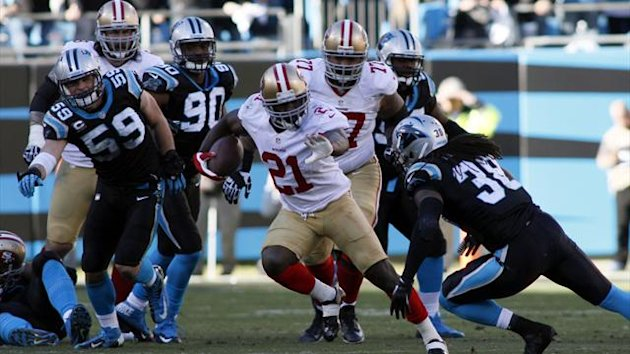 San Francisco 49ers running back Frank Gore (21) runs against Carolina Panthers strong safety Robert Lester (38) during the second half of the 2013 NFC divisional playoff football game at Bank of America Stadium