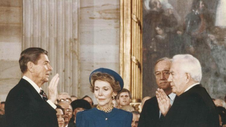 FILE – This January 20, 1985, file photo taken by Sen. Patrick Leahy, D–Vt., shows former president President Ronald Reagan, left, speaking the oath of office as his wife Nancy Reagan holds the Bible at the U.S. Capitol in Washington. At right is Chief Justice Warren Burger. For nearly four decades, Leahy,  now 72, has captured official Washington going about its business - and pleasures - in photographs as no one else has.  (AP Photo/Sen. Patrick Leahy, File)