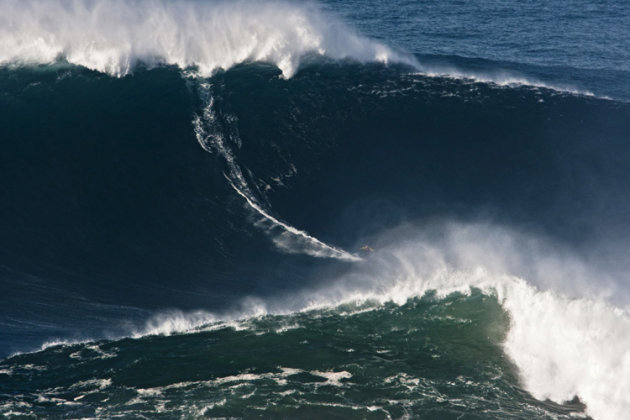 FILE - In this photo taken Nov. 1, 2011, and released by Nazare Qualifica/Polvo Concept Thursday, Nov. 10, 2011, Garrett McNamara, of Hawaii, surfs what is being called the tallest wave ever ridden at the Praia do Norte beach in Nazare, Portugal. McNamara took away honors at the Billabong XXL Big Wave Awards Friday May 4, 2012 and also set a world surfing record for surfing a wave measured by experts as 78 feet. A panel of big wave surfing and photography experts, who analyzed and measured the photos and videos of Garrett's ride, determined the height of the wave. McNamara now has the Guinness World Record for the largest wave ever surfed after riding the 78-footer in November 2011 off the coast of Nazare, Portugal. (AP Photo/Nazare Qualifica/Polvo Concepts, Jorge Leal) EDITORIAL USE ONLY NO SALES