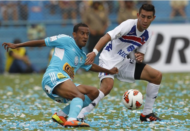 Erik Godoy of Argentina's Tigre and Junior Ross of Peru's Sporting Cristal compete for the ball during their Libertadores Cup soccer match in Lima