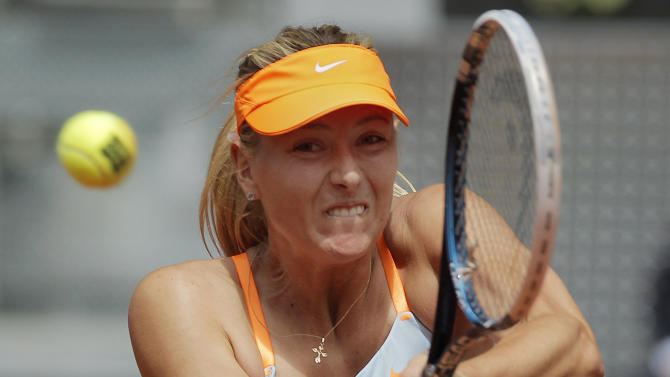 Maria Sharapova from Russia returns the ball during the match against Sabine Lisicki from Germany at the Madrid Open tennis tournament, in Madrid, Thursday, May 9, 2013. (AP Photo/Andres Kudacki)