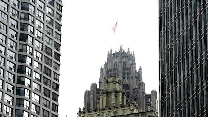 FILE - This Tuesday, Aug. 21, 2007, file photo, shows the Chicago Tribune building,i n Chicago. Tribune Co. emerged from a Chapter 11 restructuring Monday, Dec. 31, 2012, more than four years after the media company sought bankruptcy protection. The reorganized company is starting with a new board of directors and new ownership that includes senior creditors Oaktree Capital Management, Angelo, Gordon and Co., and JPMorgan Chase and Co. (AP Photo/M. Spencer Green, File)