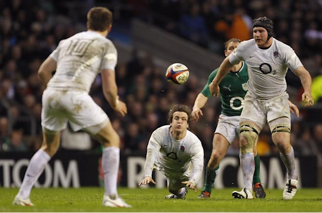 Lee Dickson of England (2nd L) passes the ball to Owen Farrell of England (L) during the Six Nations International rugby union match between England and Ireland at Twickenham Stadium in south-west Lon