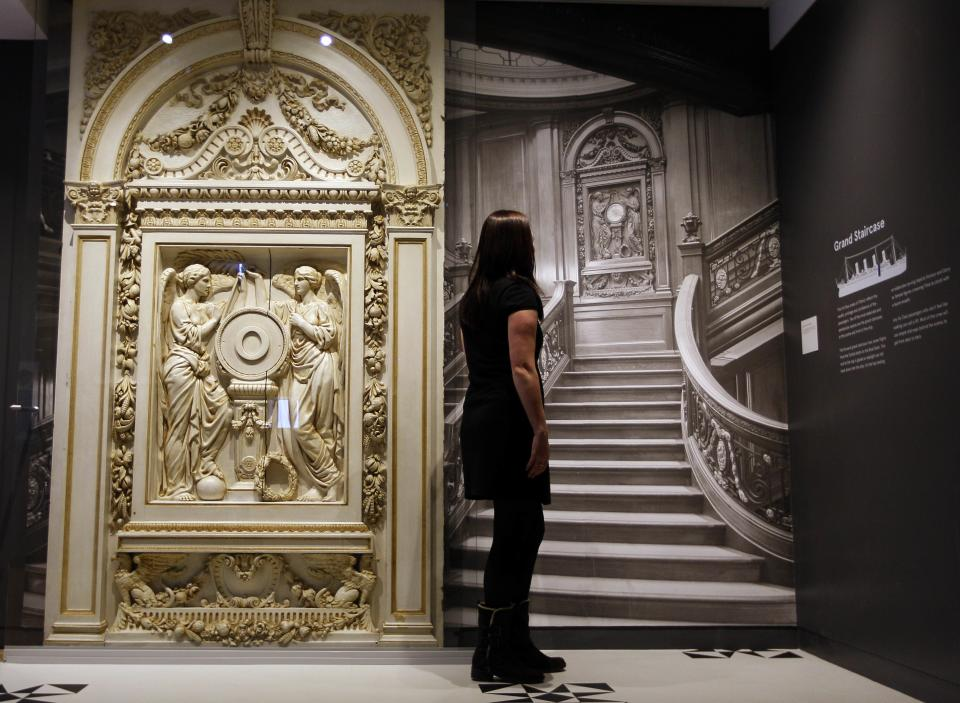 A woman looks at a photograph of the Grand Staircase from the Titanic, at SeaCity Museum in Southampton, England,Tuesday, April 3, 2012. The new museum will open in the City of Southampton on April 10, 100 years after the ill fated Titanic sailed from the City's docks. (AP Photo/Kirsty Wigglesworth)